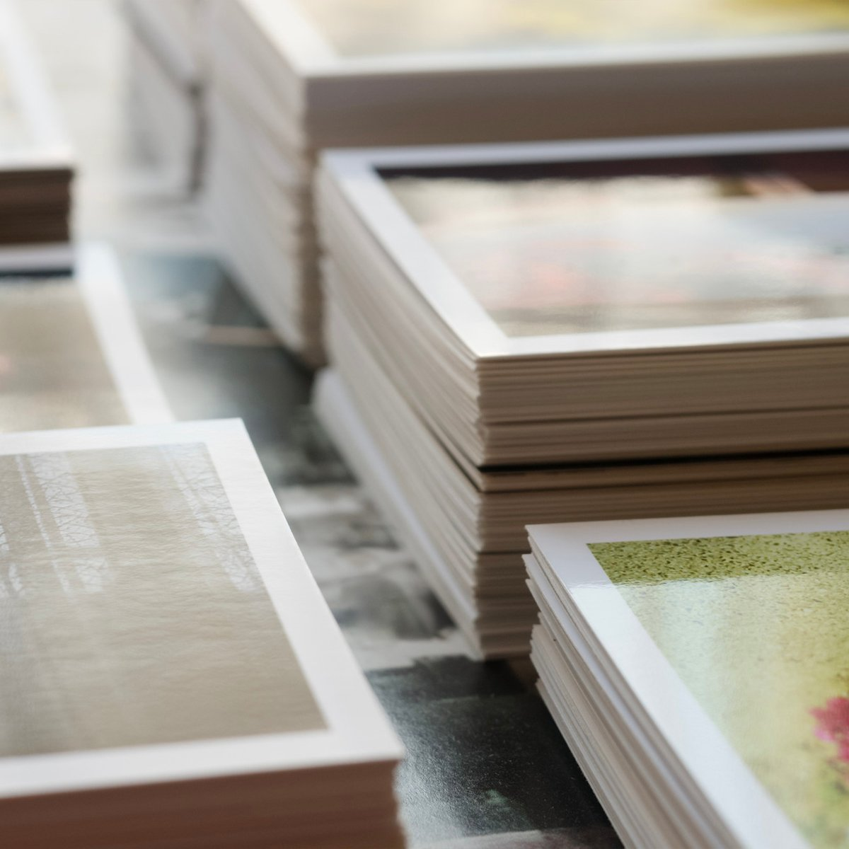 postcards stacked on a table
